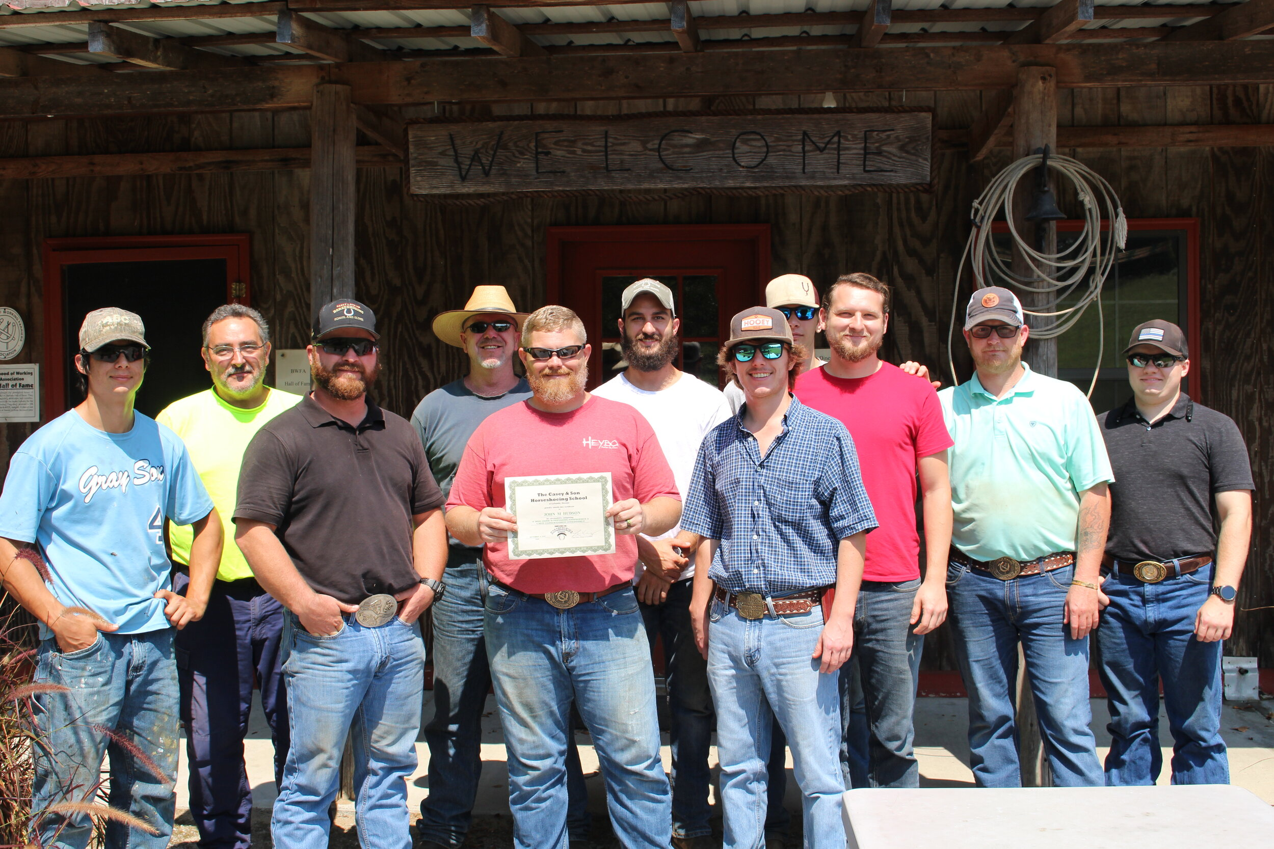 John M. Hudson with a good lookin' group of Casey Horse Shoeing School future farriers!