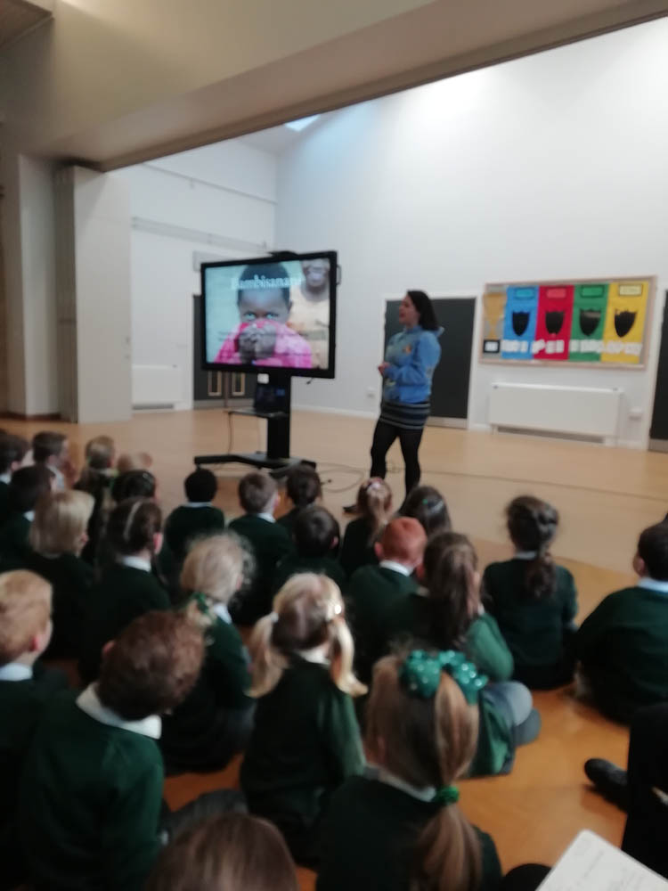 Charlotte Walker presenting an assembly at St. Joseph's Pudsey