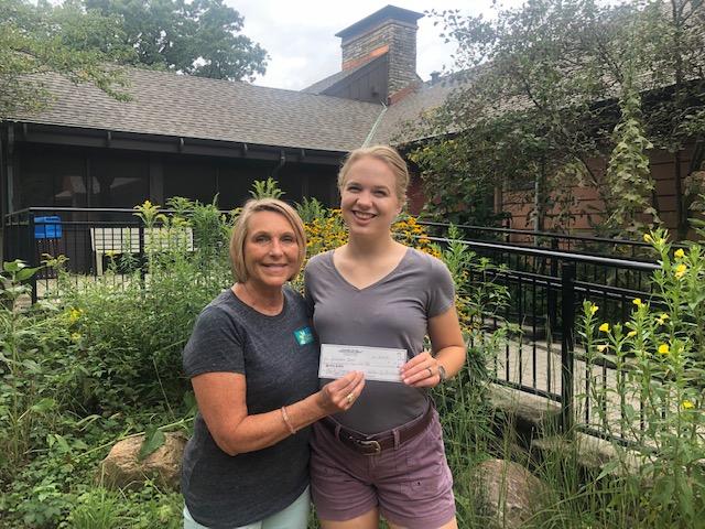 Delivering donation to Severson Dells Nature Center