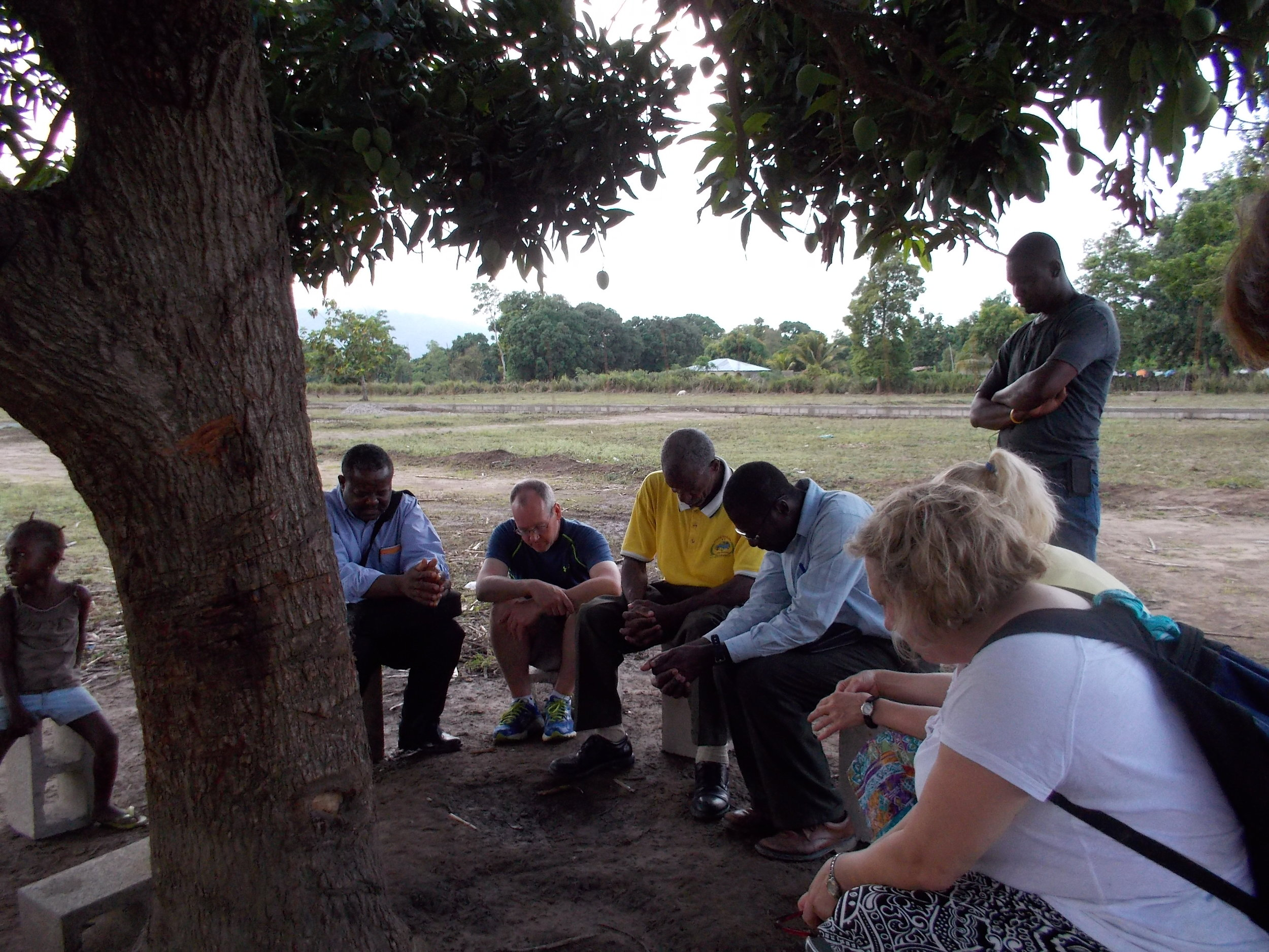 Praying with Haitian Prayer warriors 2014.1.JPG