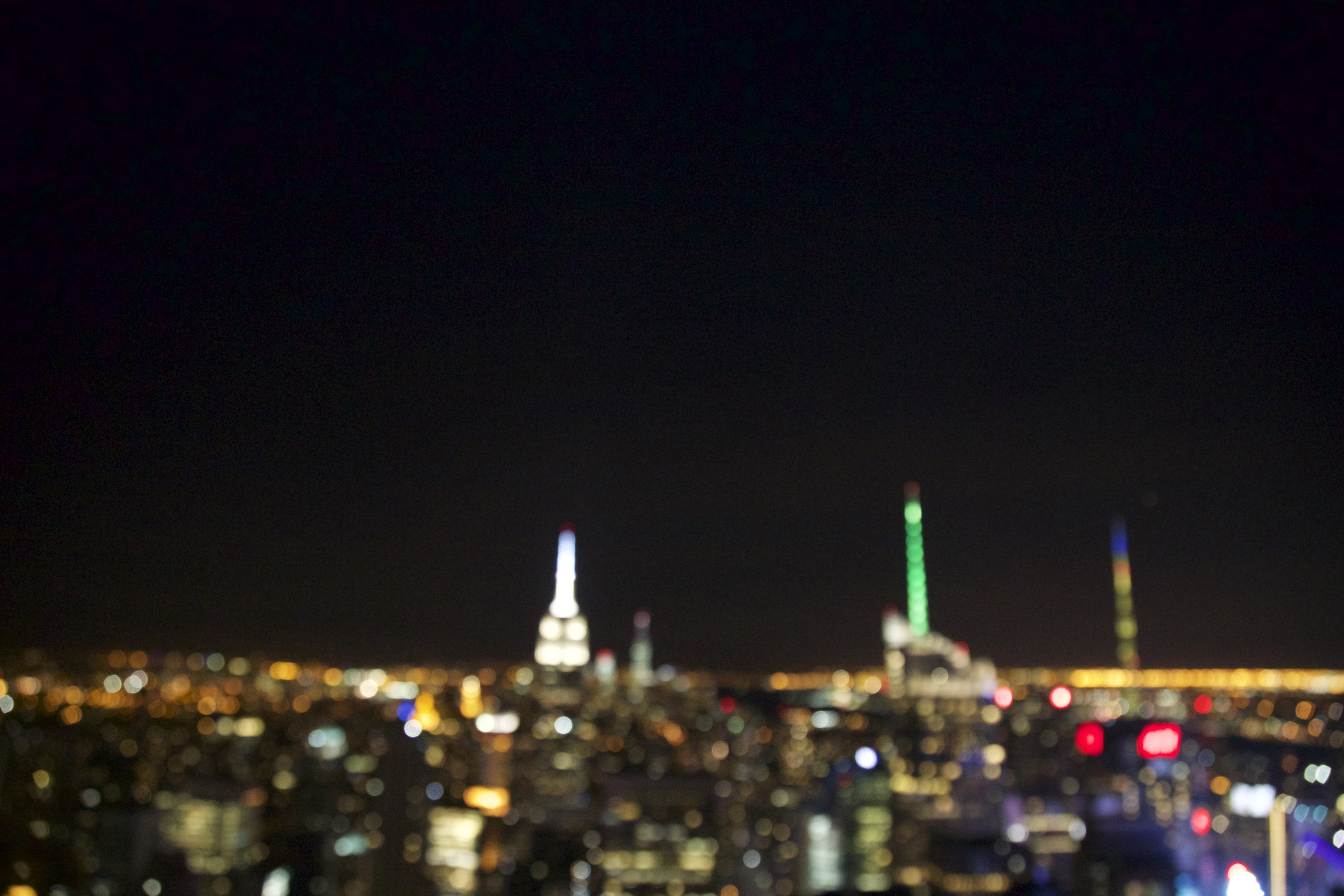 "This is my first blog post, and for those who can't tell, the photo above is of the New York skyline by night. This was my first time going to the ""Top of the Rock"" and i shouldn't have done it at night, for the view would've been better during the day. I will have more opportunities though because New York is my second most visited city - after DC, which is where I live. As i travel back and fourth between the two cities, you will see photos of people I meet and the places I go within the cities that I deem worthy of photographing. I use a Canon 5D Mark iii with a kit lens (24-105mm f/4) and I am saving up for better equipment. I have my sights set on a 35mm f/1.4 or something of the sort for portraits and landscapes.  Booked at f/4 is very minimal, and I'm hoping to be able to increase the effect in the future."