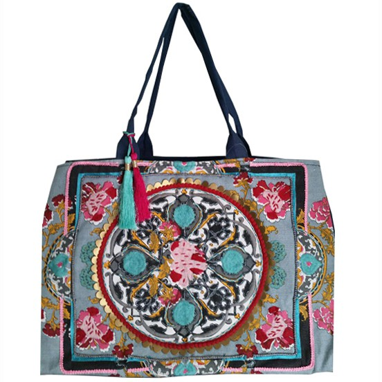 No trip to the water is complete without a summer beach bag! Debbie Katz's bohemian flare is perfect for days in the sun. This bag is ready to carry anything; from towel, to sunscreen, to literature, this bag has you covered!