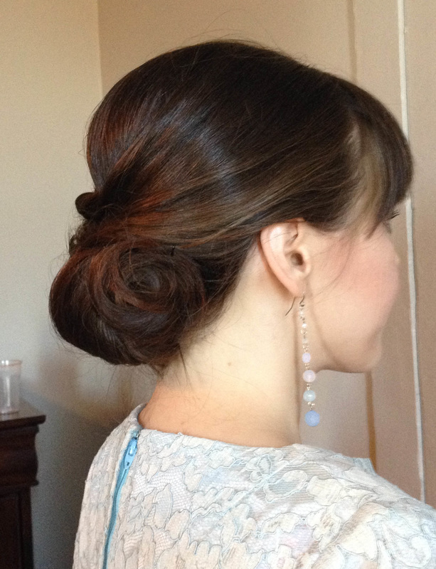 Simple and perfect for the bride wanting to flaunt her bangs. | Hair:  Blush and Bashful  |  Photo Credit