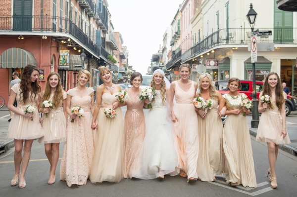 This NOLA wedding party completely nails the mismatched bridesmaid dress look. |  Photo  by  Catherine Guidry  via  Style Me Pretty