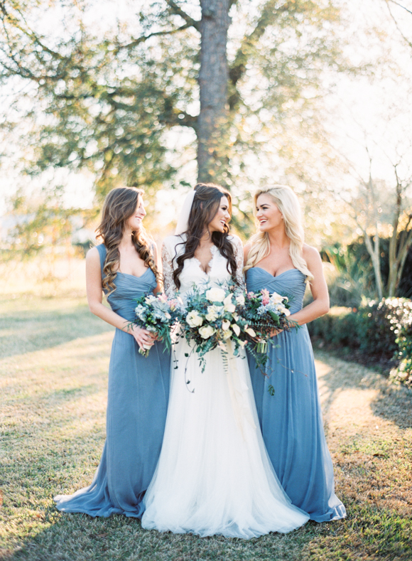 Another example of keeping the same color throughout, but allowing your girls to personalize their necklines. |  Photo  by  Marissa Lambert Photography  via  Wedding Sparrow