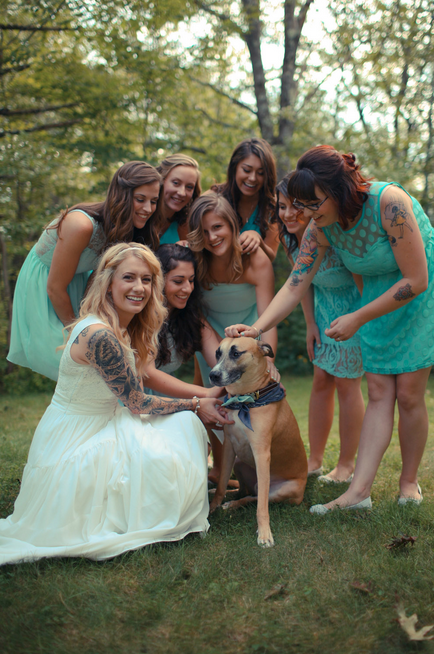 Don't forget the group shots on the big day!  |  Photo by  Ryan Eyestone  via  Rock n' Roll Bride