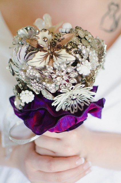 I love the idea of a brooch bouquet!  |  Photo by  Suzuran Photography  via  Offbeat Bride