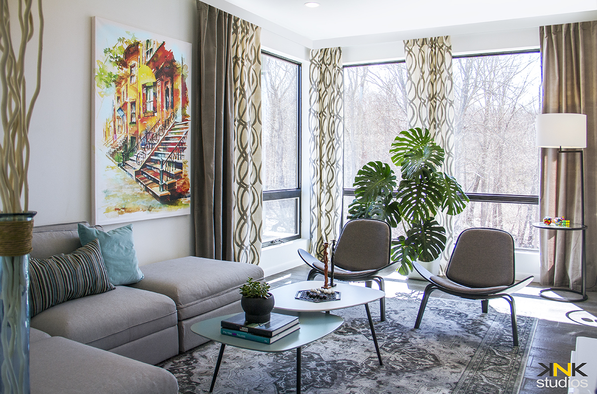 The Canvas Print of South End Painting, adds more colors and depth on this Media/Family Room. The large size art, balances the large windows and adds more interest on the white wall.  *contact us for pricing and sized of canvas prints of different artworks.