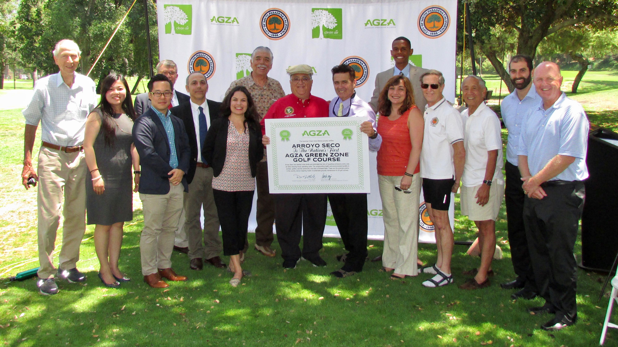 CA State Senator Portantino and South Pasadena Mayor Cacciotti hold the AGZA Green Zone Certification, flanked by representatives from city and state, SCAQMD, Donovan Bros Golf, American Lung Association, Coalition for Clean Air, Sierra Club, and Noise Free America.