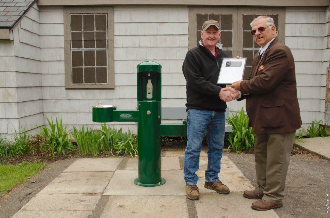 Haven Hill Gatehouse Bottle Filling Station, Bob Hoffman representing the HEC, and FOHRA President Dick Russell.