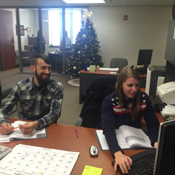 Kurt teaches Jessica about Google spreadsheets at her desk in Laclede County, Missouri