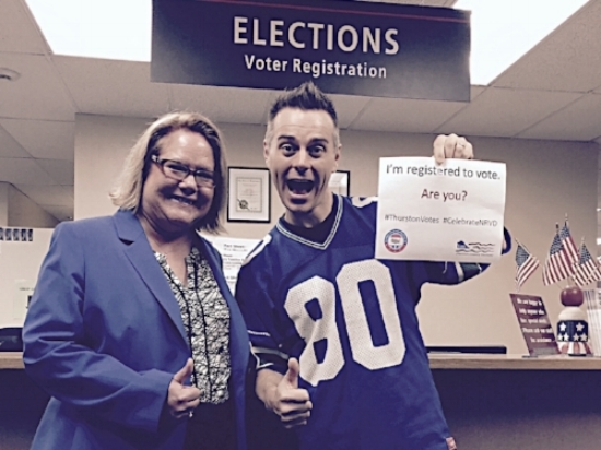 """Auditor Mary Hall and IT Consultant Ray Jacoby pose for a """"graphic campaign."""" Photo by Valerie Walston."""
