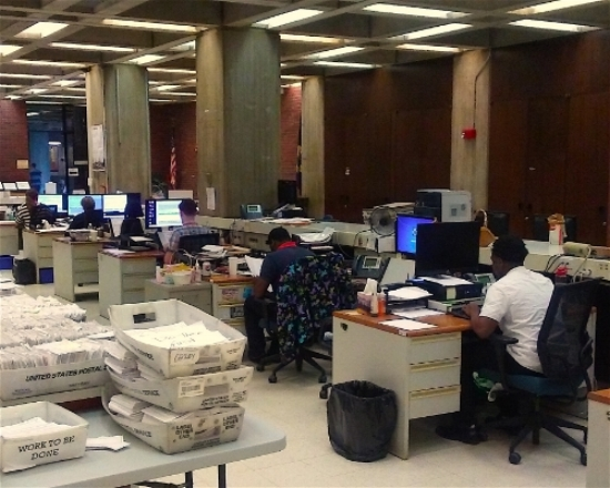 Boston election staff hard at work in the Boston City Hall. Photo by Kyron Owens.