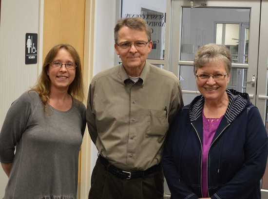 Web manager Thor Carlson flanked by Ellen and Marge. Photo by John Williams.