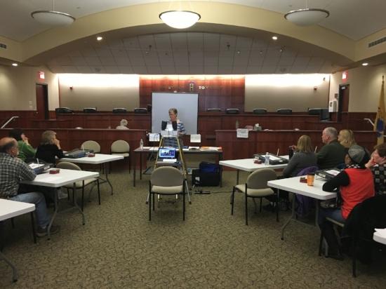 Marge Lake McCabe leads a poll worker training class. Photo by Kimberly Sidoti.