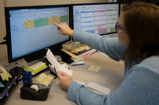 Jessica Lara shows off her office's spreadsheet. Photo by Micah Cutler.
