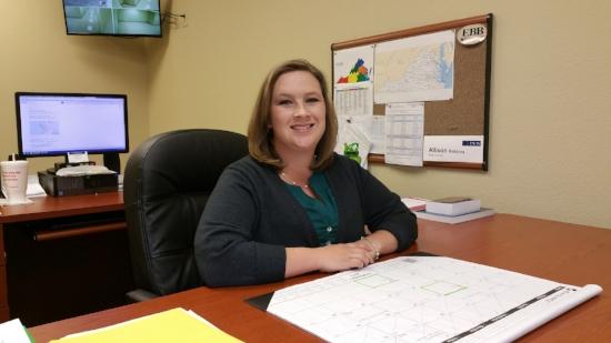 Allison J. Robbins sitting at her office desk. Photo courtesy of Allison J. Robbins.