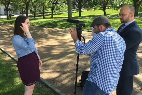 Kevin Issa and Jason Hernandez film intern Kathryn Dery for one of the RI Votes videos. Photo by Joe Graziano.