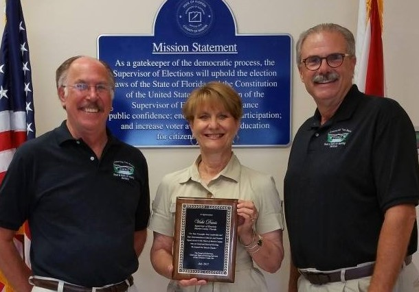 Supervisor of Elections Vicki Davis (center) receiving an award from the Deaf and Hard of Hearing Services. Photo courtesy of Martin County Elections Center.