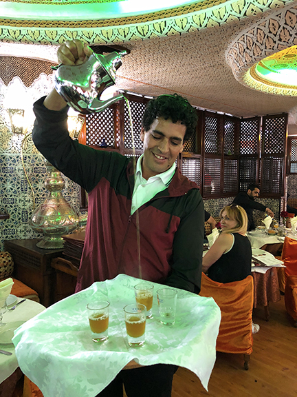 Moroccan Mint Tea being served in traditional style with panache!
