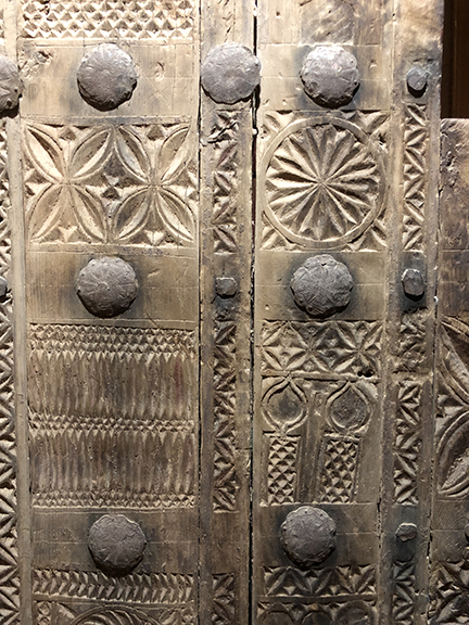 Wood chip carving in traditional patterns, coupled with beautifully hammered and detailed steel decorative elements make for a sturdy and beautiful door.