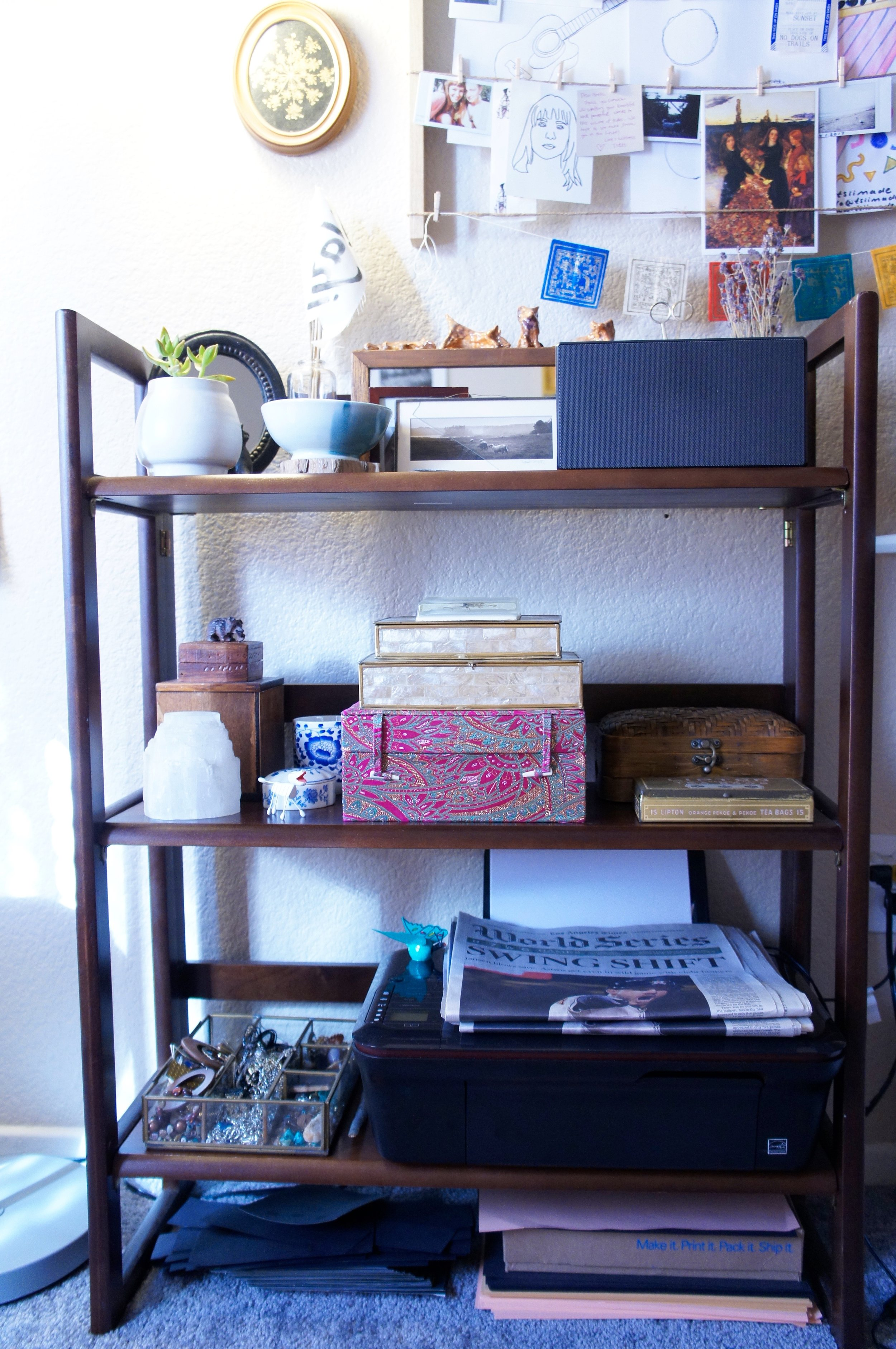 I store my jewelry supplies in my vintage box & tin collection. also shown:    la times featuring my block cloth shirts   , waiting for frames. try displaying any press on your work in your fame gua.