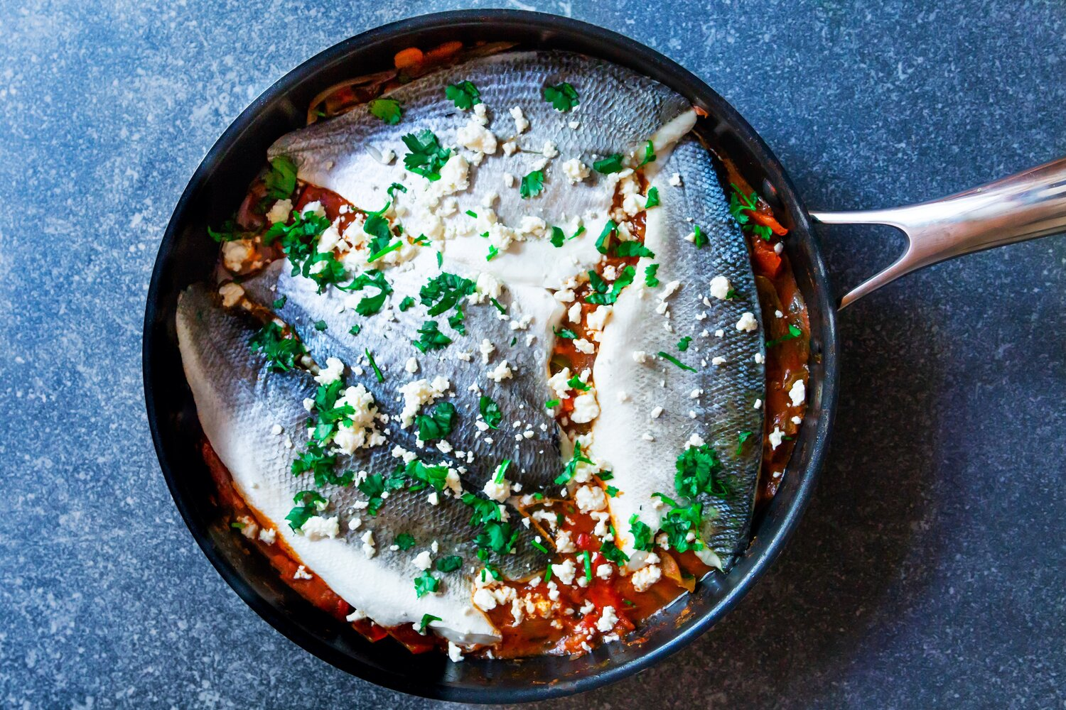 Moroccan spiced fish fillets and bell peppers in tomato sauce
