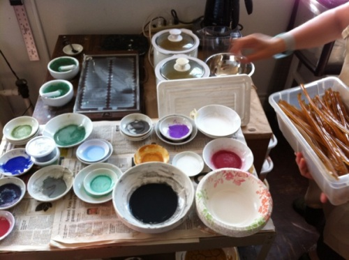 Dishes of different pigments prepared with animal hide glue (the binder used in Nihonga painting).