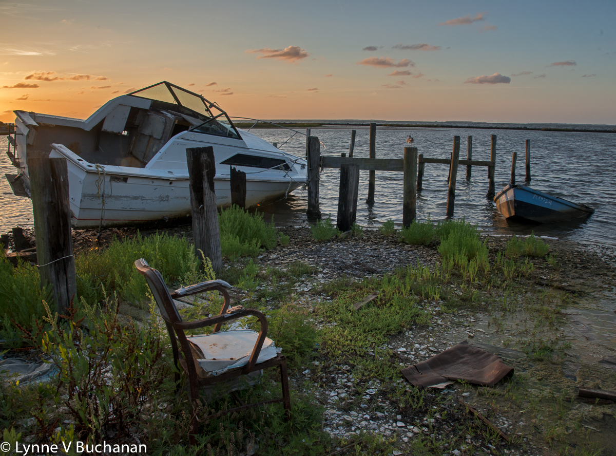 Empty Chair and Abandoned Boats, Eastpoint