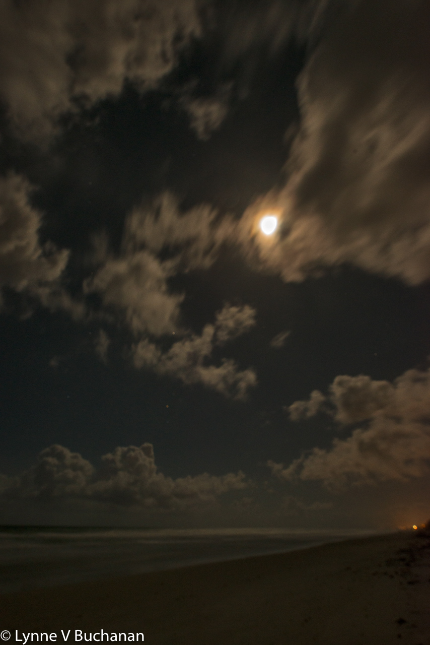 Clouds Converging on the Full Moon