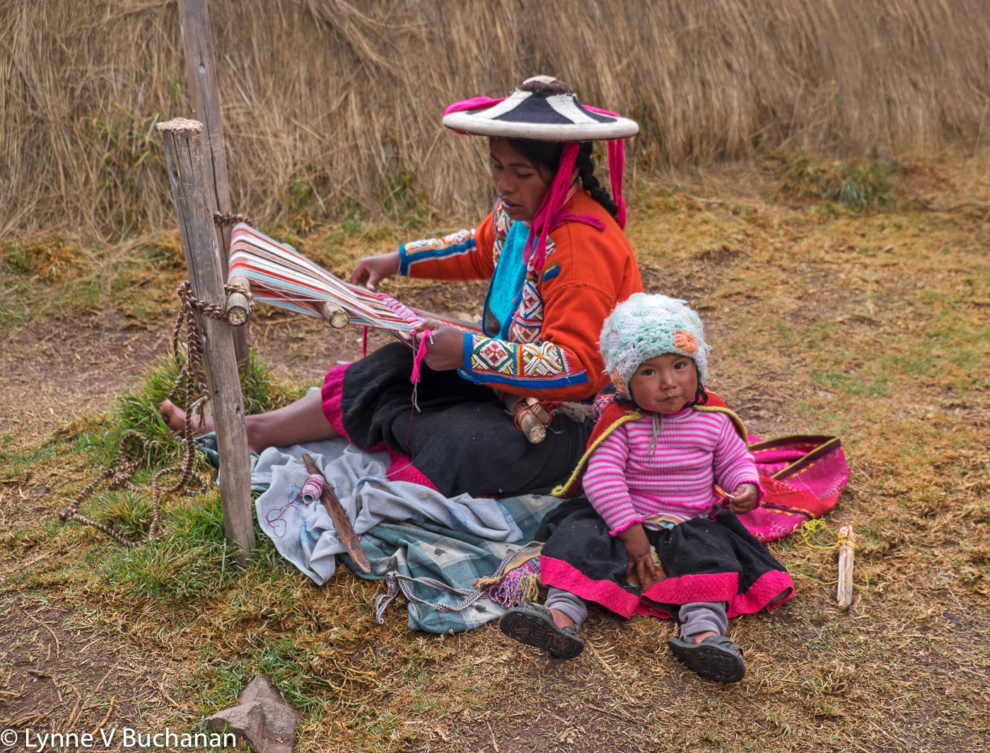 Woman Weaving with Child
