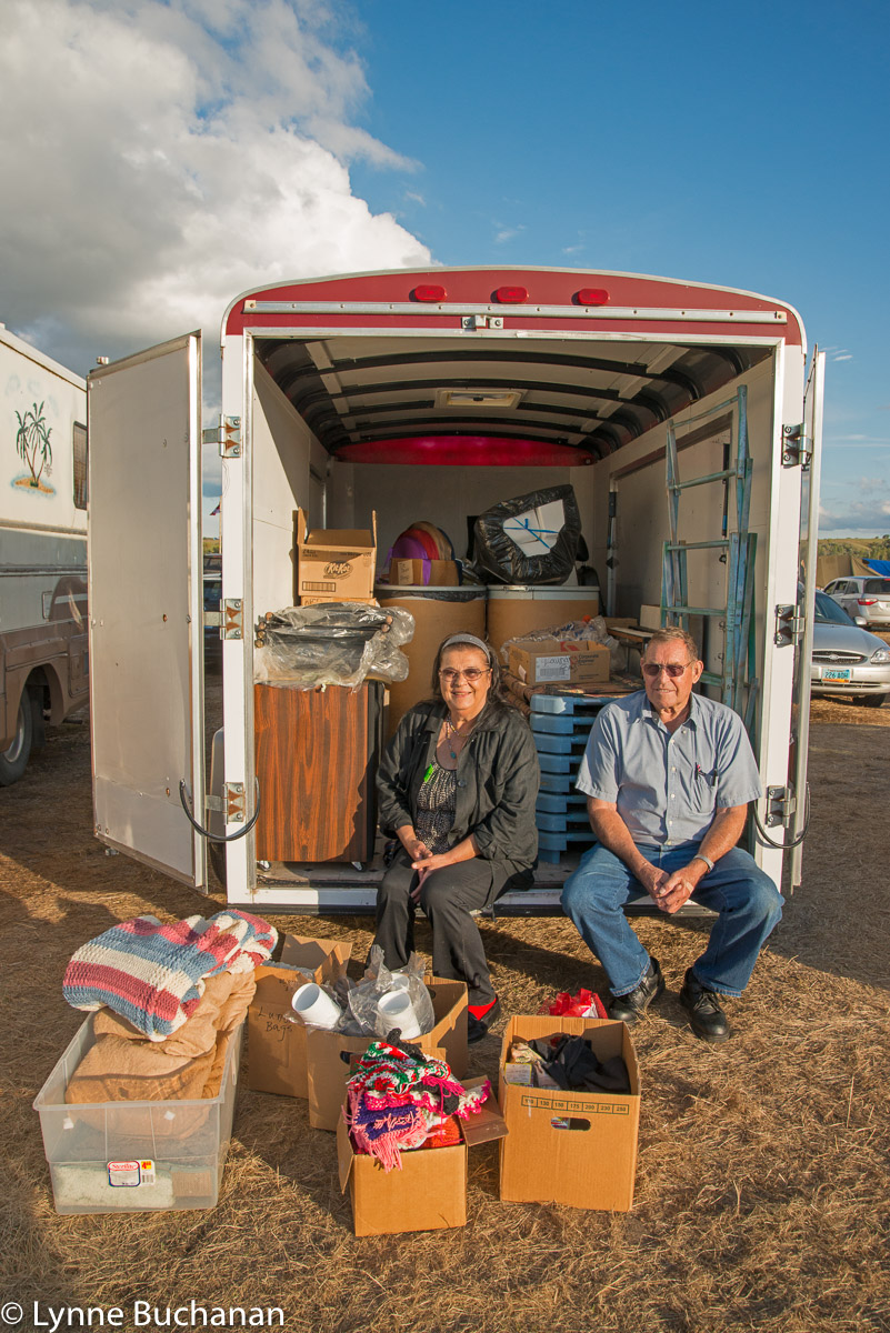 Chant and her husband with a truck full of donations