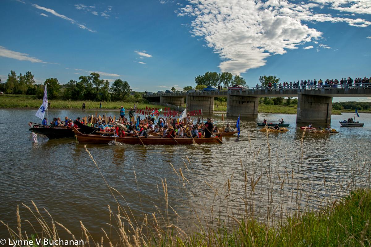 Canoes with Spectators Lining the Bridge
