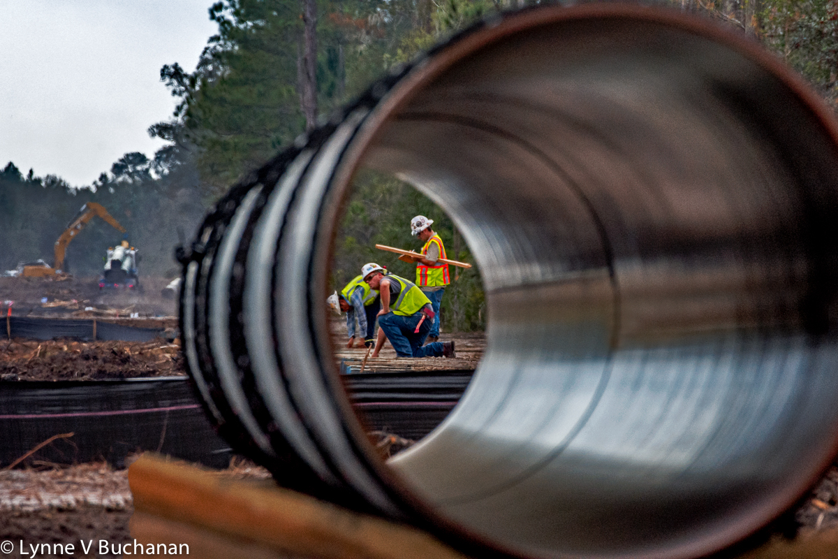 Men at Work on the Sabal Trail Pipeline through a Section of Pipe