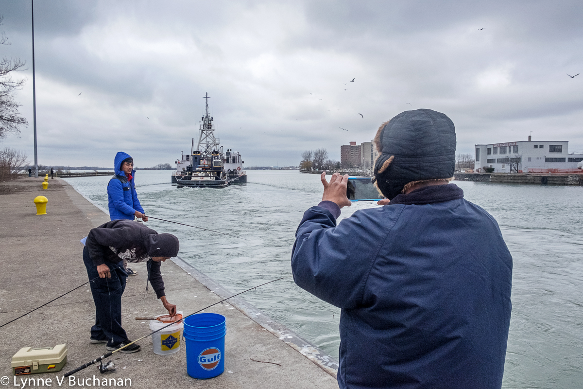 Immigrants Fishing and Photographing on the Niagraa River at the  a the Black Rock Canal Locks