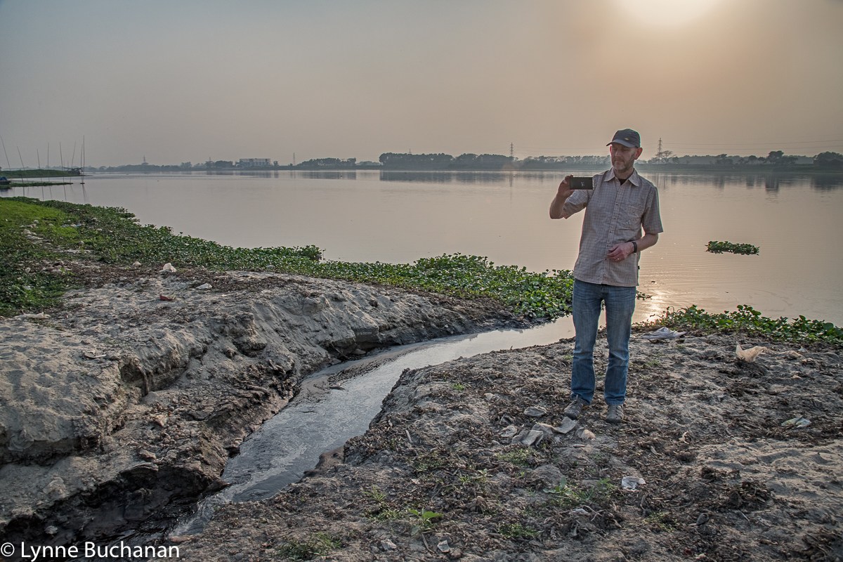 Adrian Sym Photographing Effluent Discharge from Tannery Operations as it Makes its Way into the Dhaleshwari River