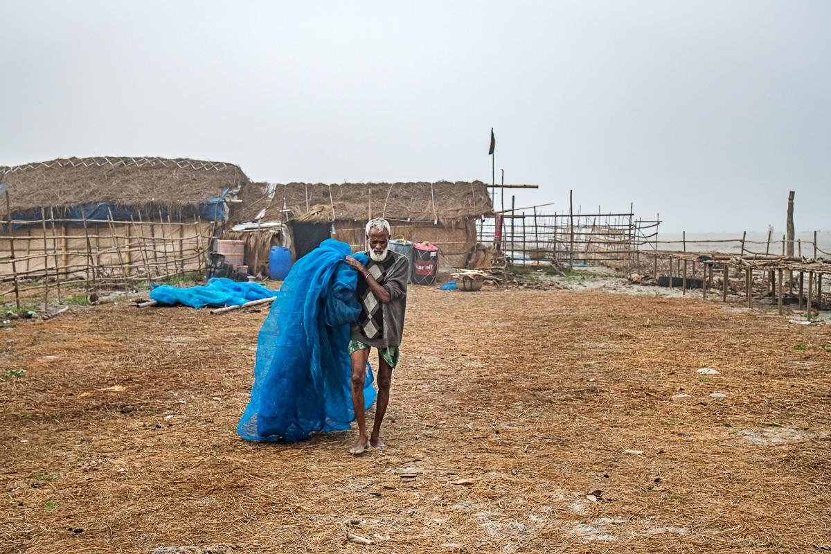 Man in Dublar Char Carrying a Fishing Net