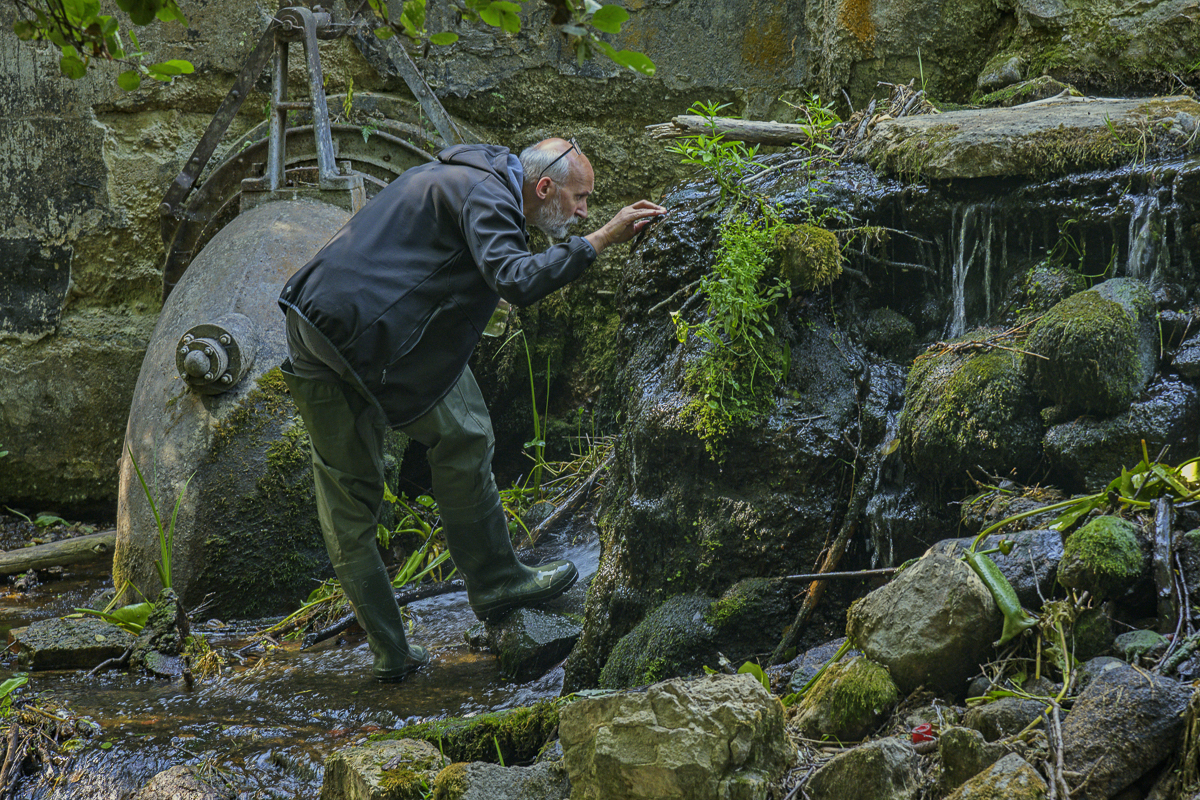 Marek collecting moss and samples