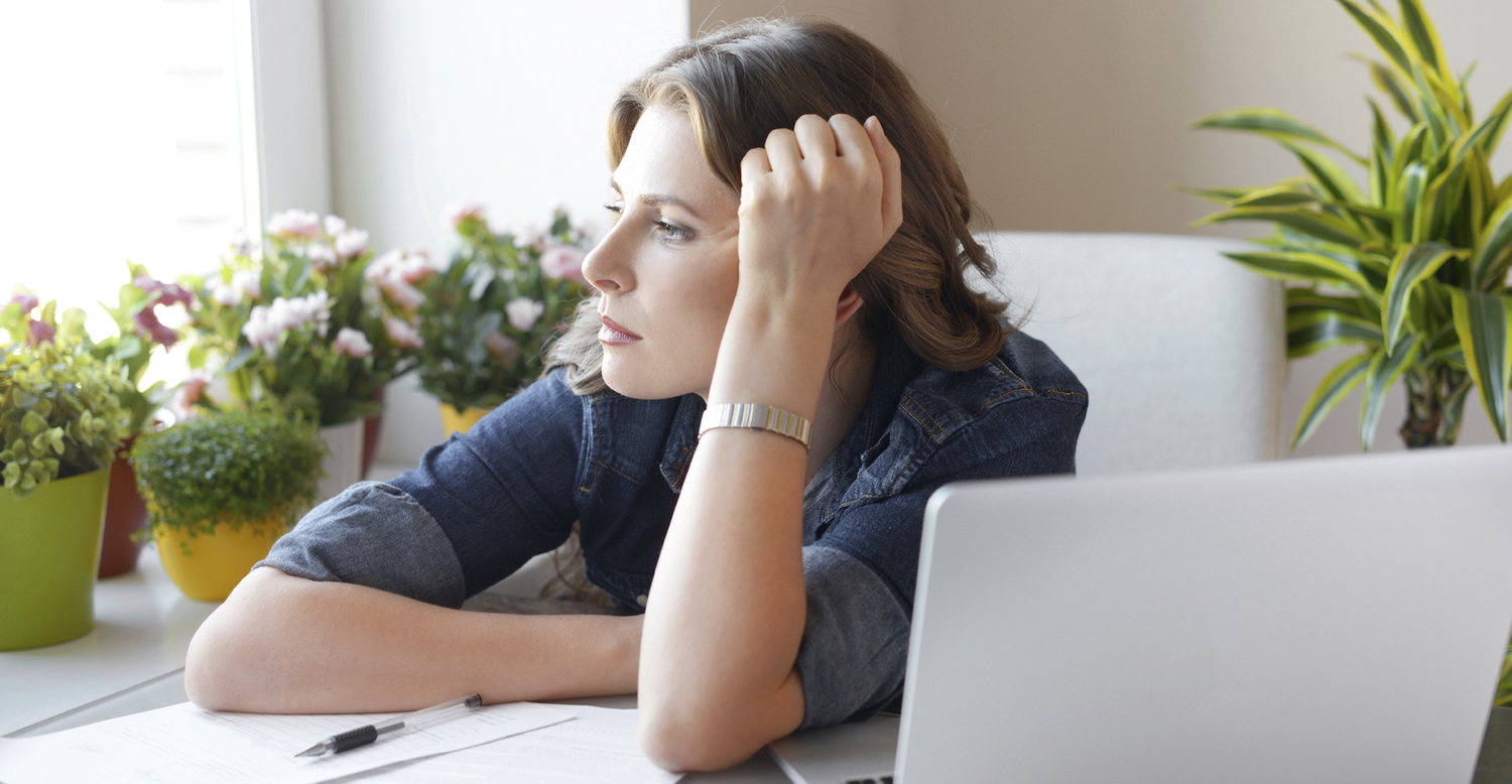 thinking woman with computer