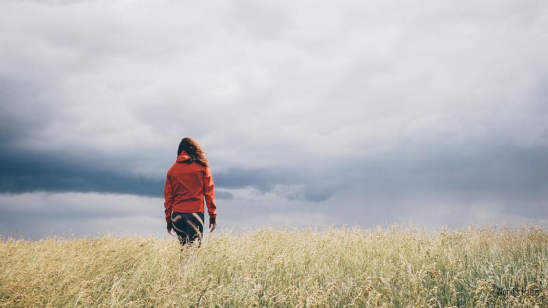 woman strolling on a field
