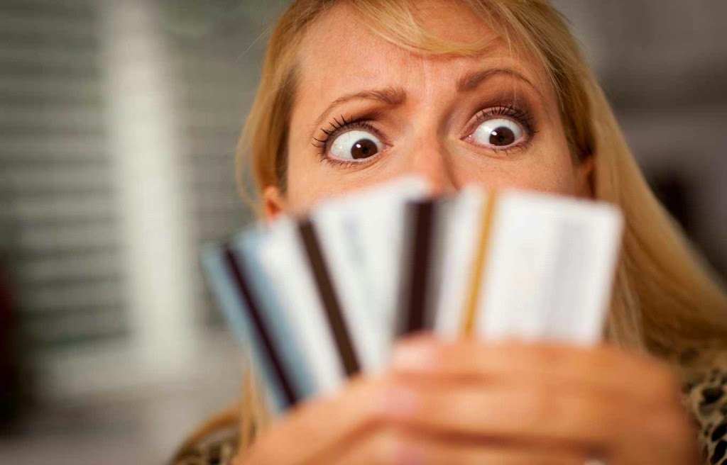 distraught woman with credit cards