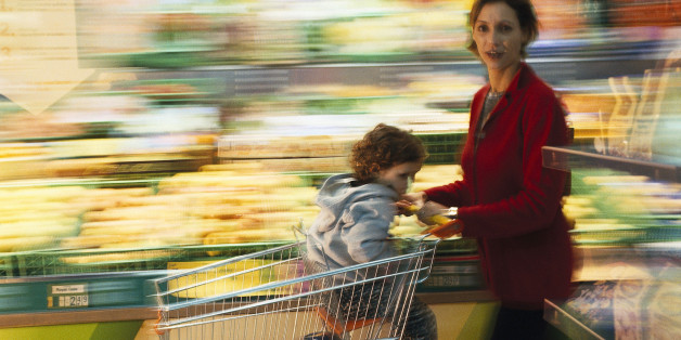 harried mom shopping with child