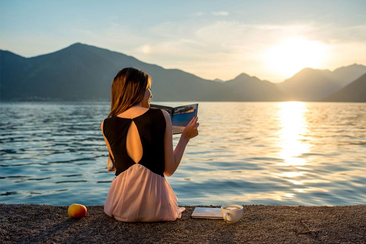 woman reading beachfront