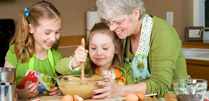 grandmother and children cooking