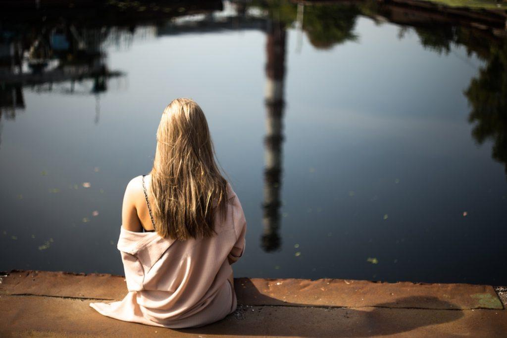 thinking woman near a lake