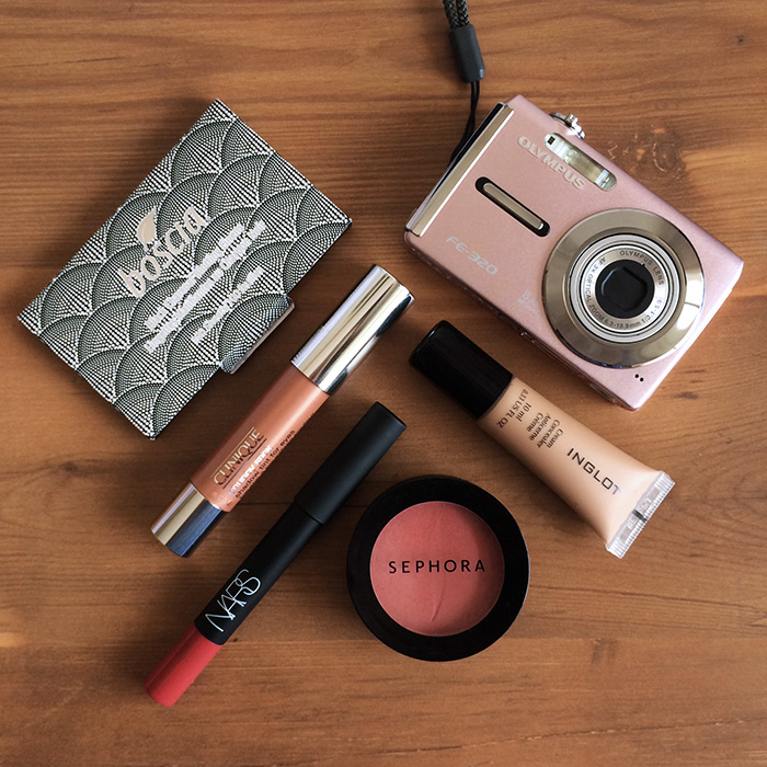 Clockwise From Top:    1) Boscia Black Charcoal Blotting Linens, 2) Inglot Cream Concealer, 3) Sephora Blush In 'Rose Glow', 4) NARS Velvet Matte Lip Pencil In 'Dolce Vita', and 5) Clinique Chubby Stick Shadow Tint For Eyes In 'Ample Amber'