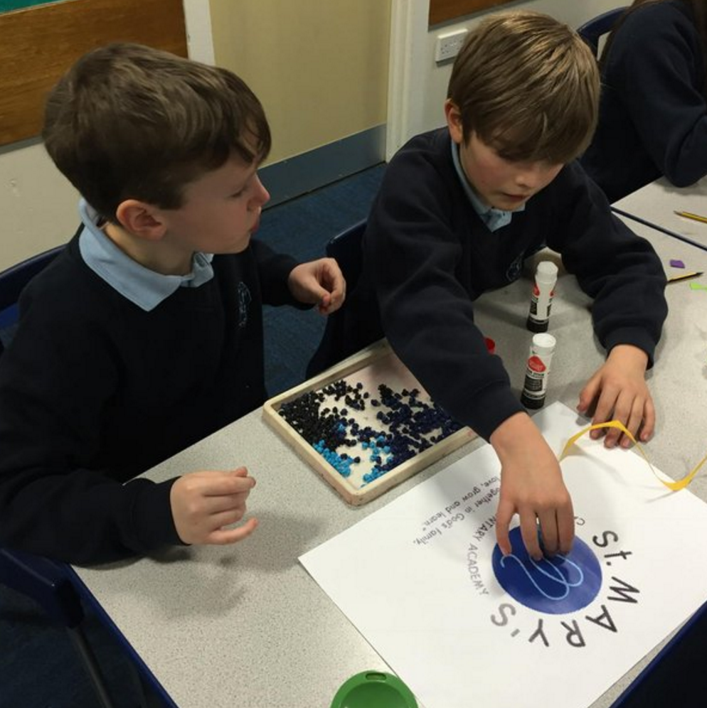 Photo: We enjoy art and design! Year 6 Pupils working on the St. Mary's badge