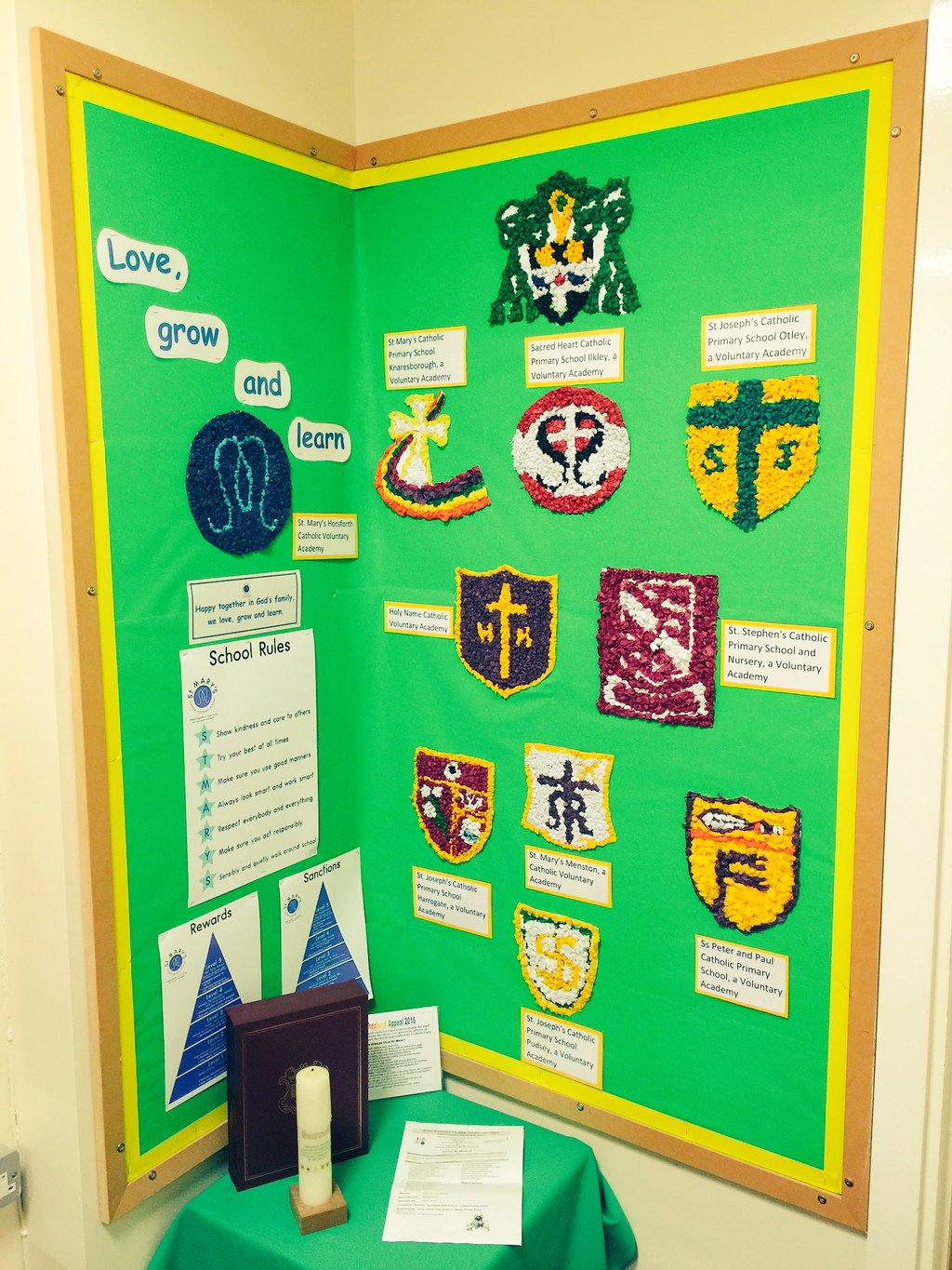Photo: Each school's badge has been skillfully recreated in a medium which required simplifying the elements of each badge.
