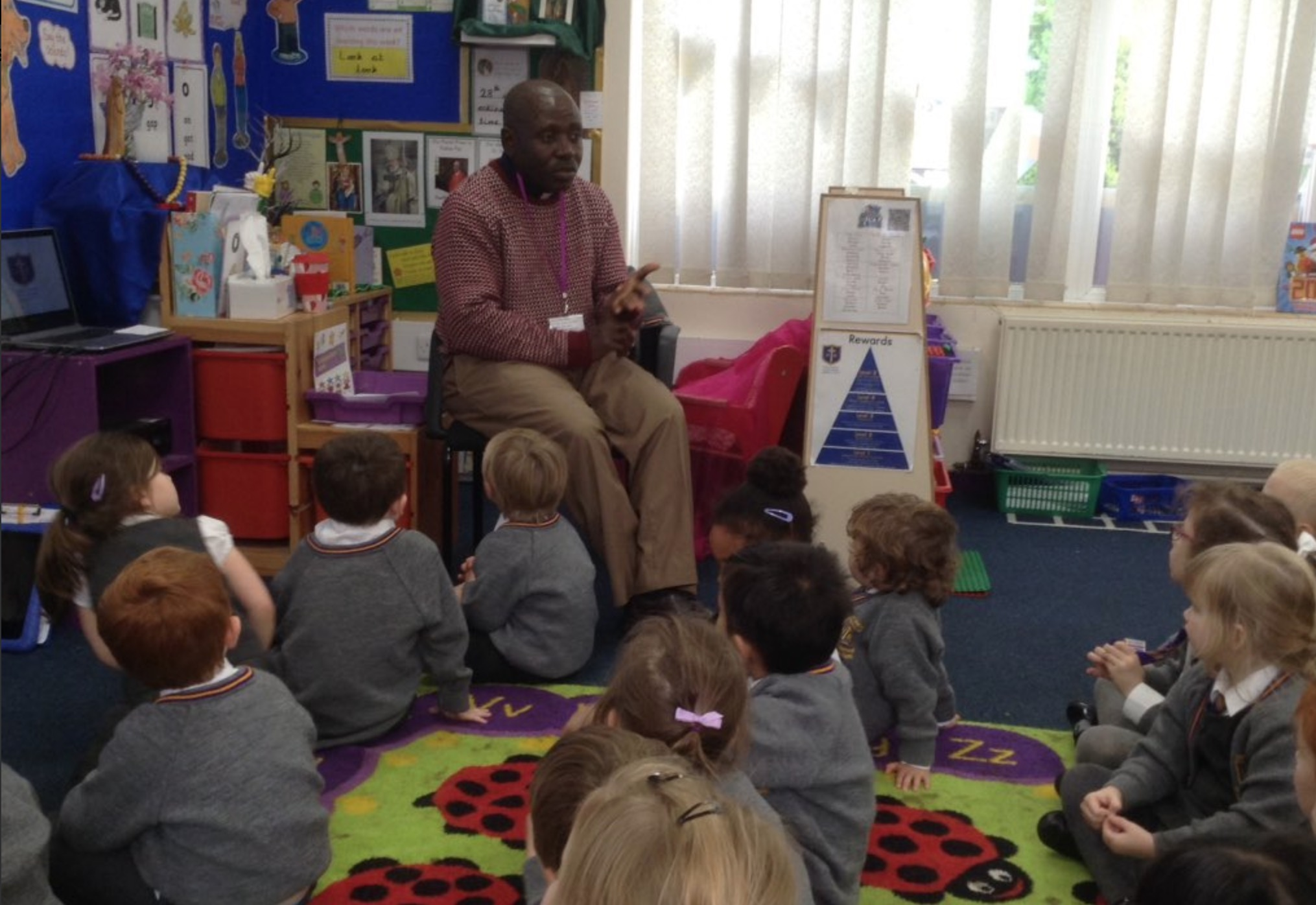 Photo: Fr. Emmanuel came to visit Reception class at Holy Name and we said part of our rosary decade together.