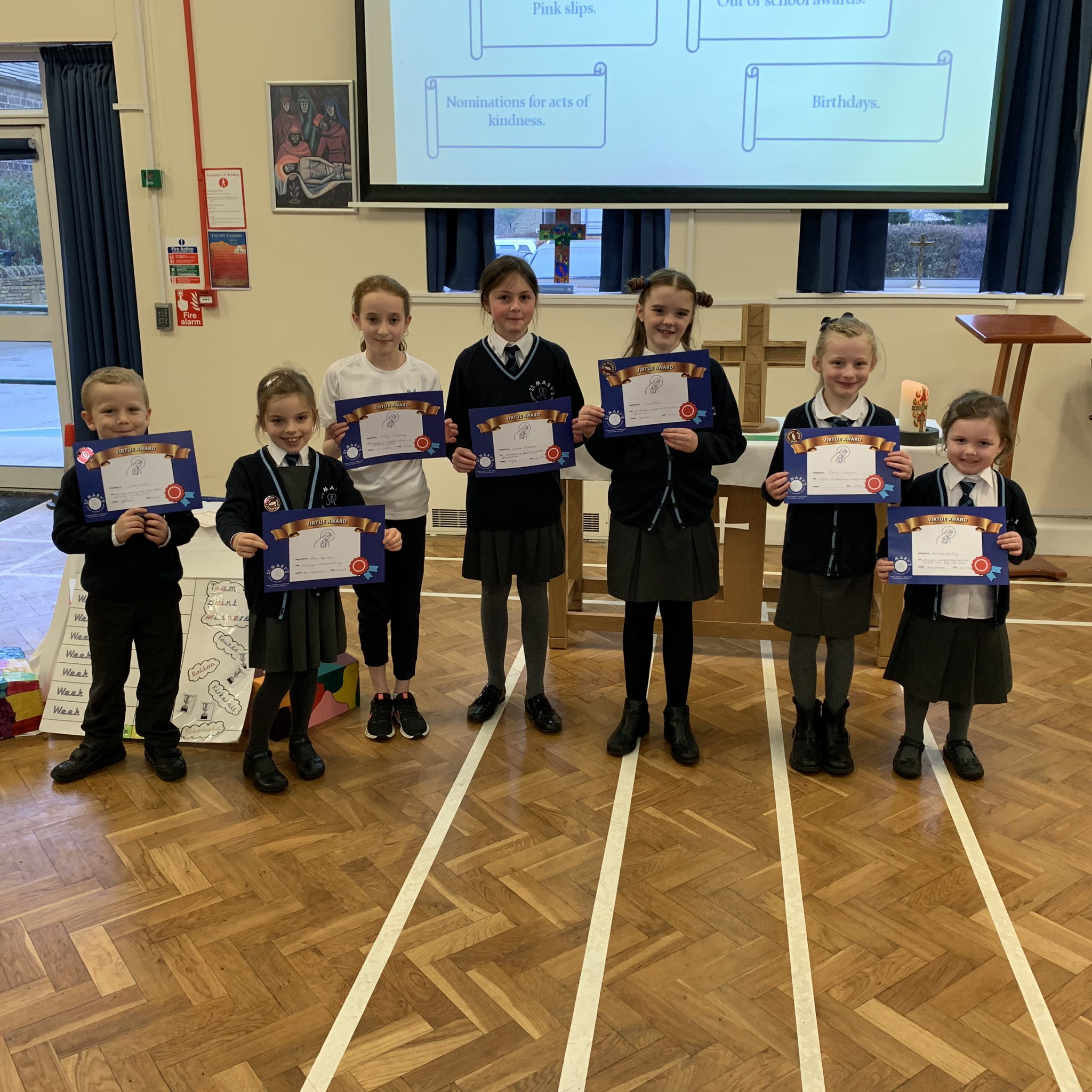 Photo: Children with Virtue Awards at Friday's assembly. This week's focus was on co-operation.